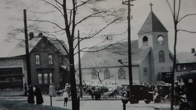 The church in its golden era when it was still surrounded by homes owned by Lithuanians
