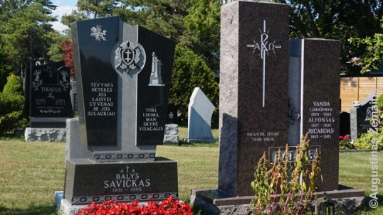 Many graves, like this one of Balys Savickas, have Lithuanian patriotic symbols and inscriptions. The inscription on the left grave says 'After losing my homeland I lived for its freedom and I lived to see it', referencing to him dying in 1996 after Lithuanian independence was restored. The inscription on the other side of the same grave adds 'Such was my fate given to me by the Almighty'. Symbols on this grave are the Vytis (Lithuanian coat of arms), Cross of Vytis and the Three Crosses memorial, a potent symbol of Vilnius and of Soviet repression as it was demolished by the Soviets and then rebuilt by Lithuanians as independence seemed real