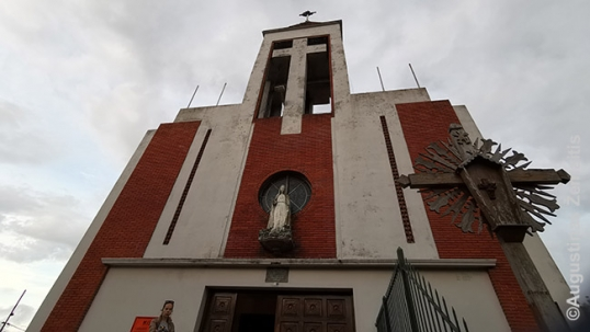 Lithuanian church of uruguay with a tradtional Lithuanian cross next to it