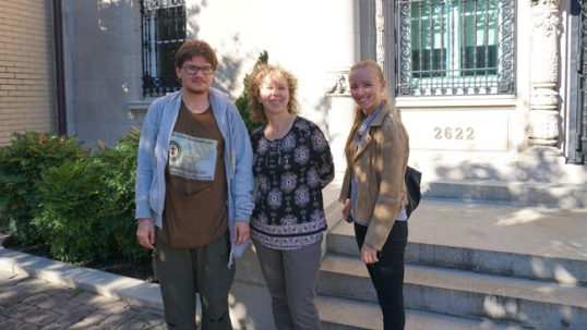 The leader of Destination America project Augustinas Žemaitis (left) stands with Lyra Puišytė (middle) near the Lithuanian embassy in Washington, DC