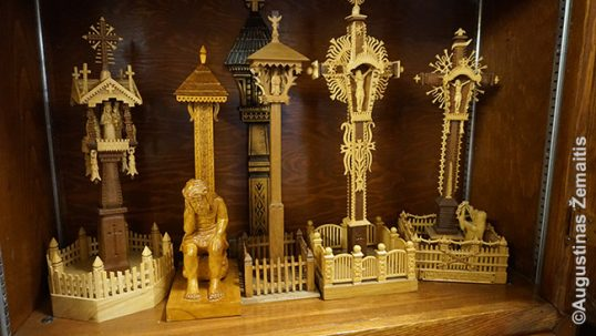Miniatures of traditional Lithuanian woodcarved crosses and chapel-posts in ALKA