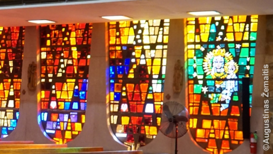 Stained glass windows of the Brighton Park Lithuanian church of Immaculate Conception with the Our Lady of Šiluva tricolor window on the right