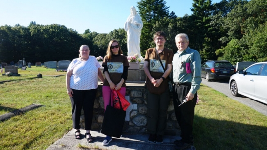 Destination - America team together with Jonas Stundžia at the Lawrence Lithuanian cemetery