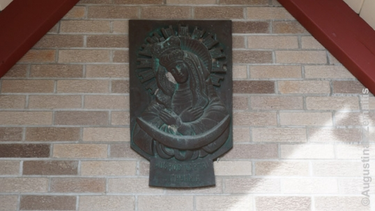Our Lady of Vilnius symbol over the door of St. Mary church of Custer