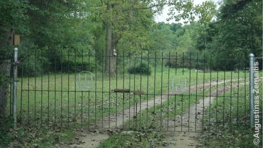 Camp Pilėnai entrance gate with Columns of Gediminas symbols