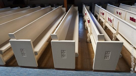 Pews adorned in crosses of Vytis at the Transfiguration Lithuanian church