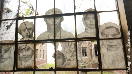 Images of immigrants as an art project at the abandoned Ellis Island hospital