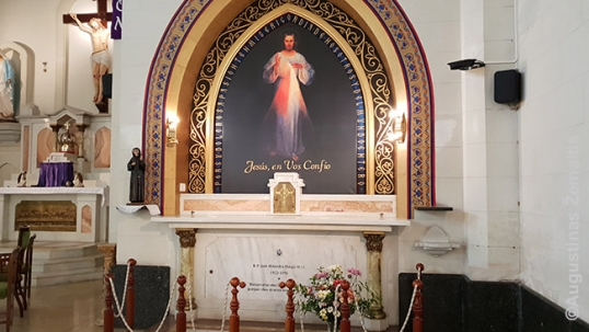 Priest Margis grave under an image of Divine Mercy