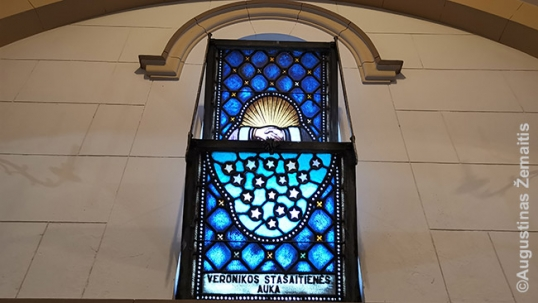 One of the stained glass windows of the Lithuanian church with a donor's name